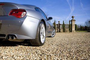 2586180 - sliver sports car on driveway