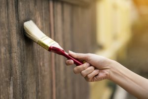 76240611 - applying protective varnish on a wooden texture