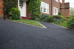 9457682 - new bitumen driveway outside a beautiful brick house in london. plenty of space for text.